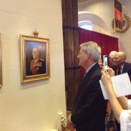 Our Chairman contemplating the painting of HM King Olav V